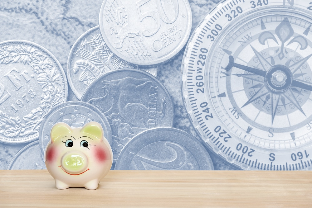 piggy bank with currency graphic