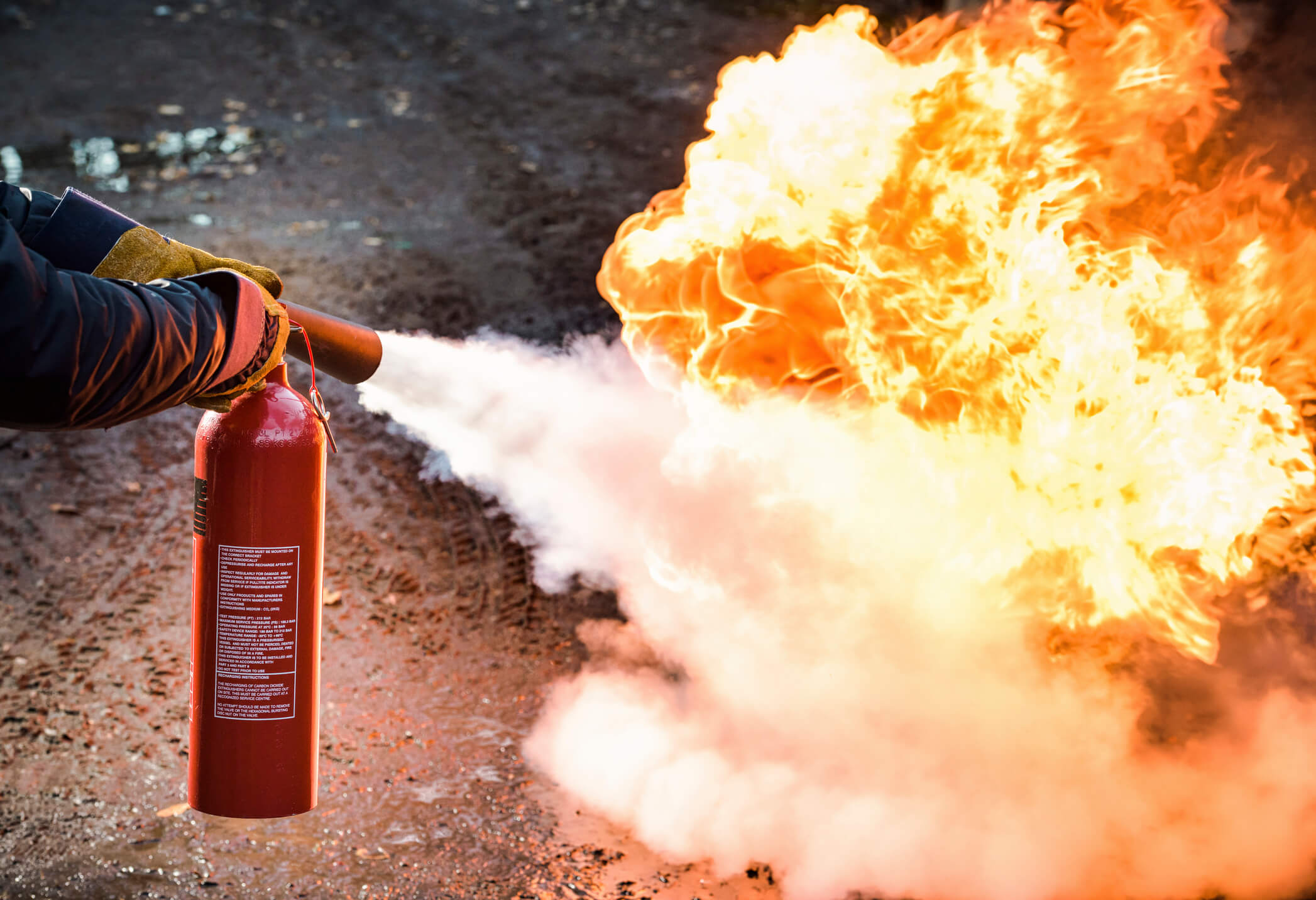 fire extinguisher putting out fire