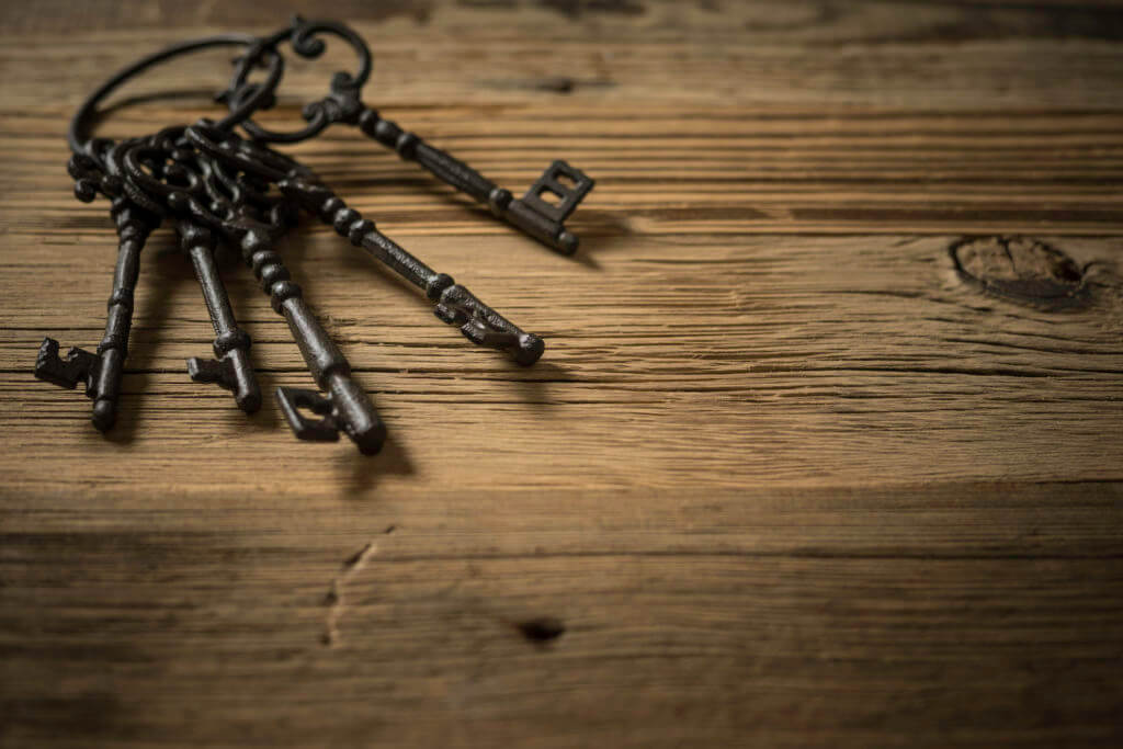 old keys on wooden table