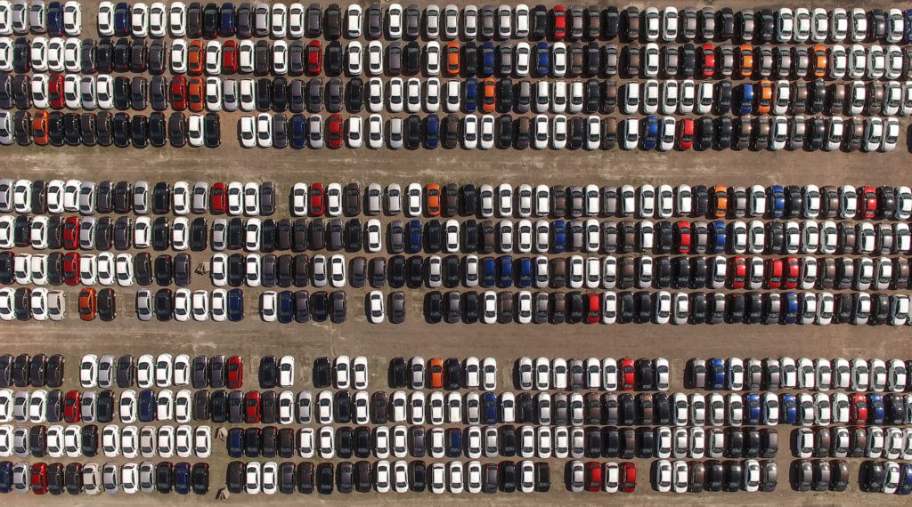 aerial view of cars in a lot
