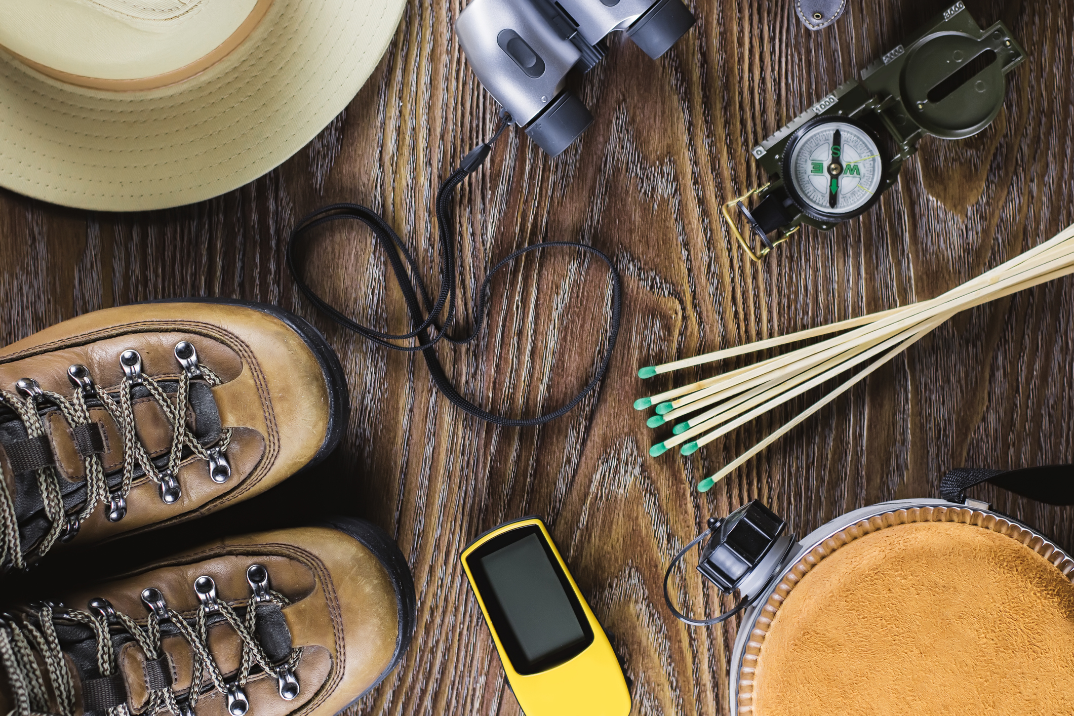 hiking equipment on wood background