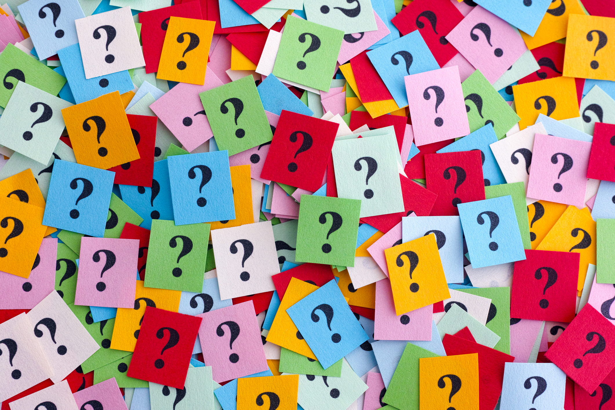 question marks on colorful post its