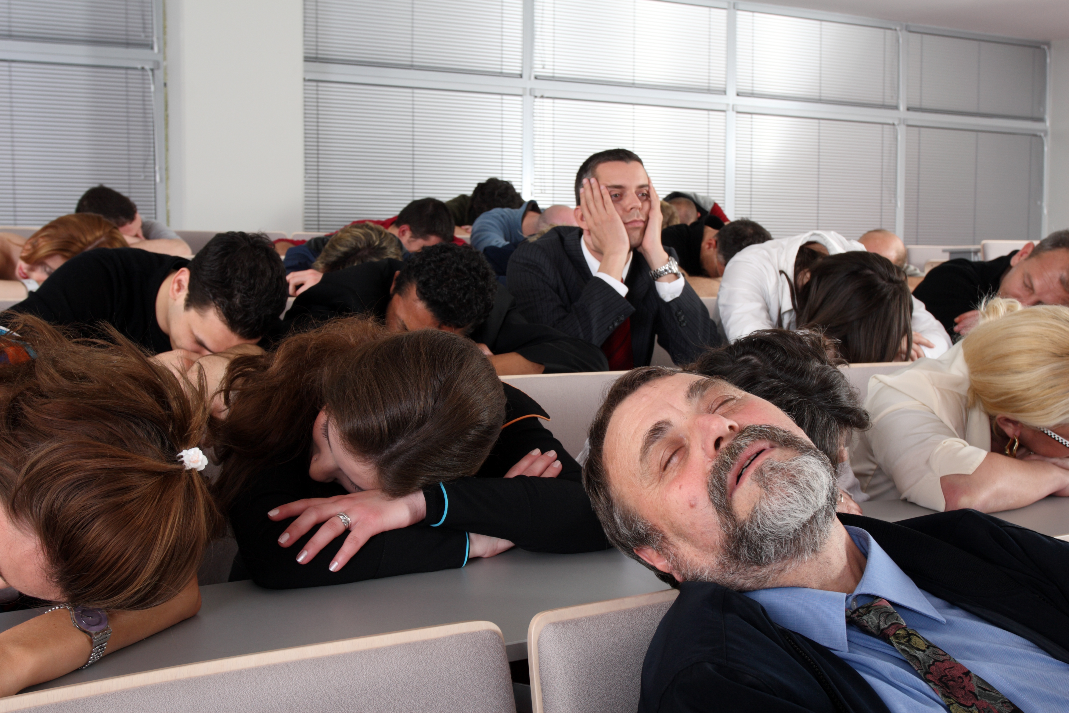 business people sleeping in seminar