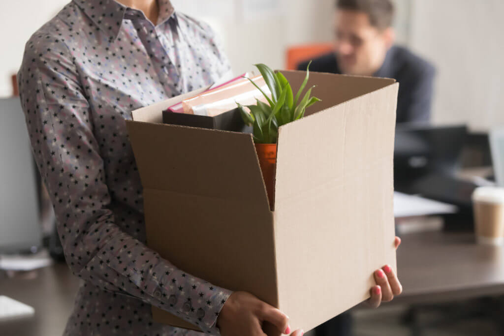employee with things in box