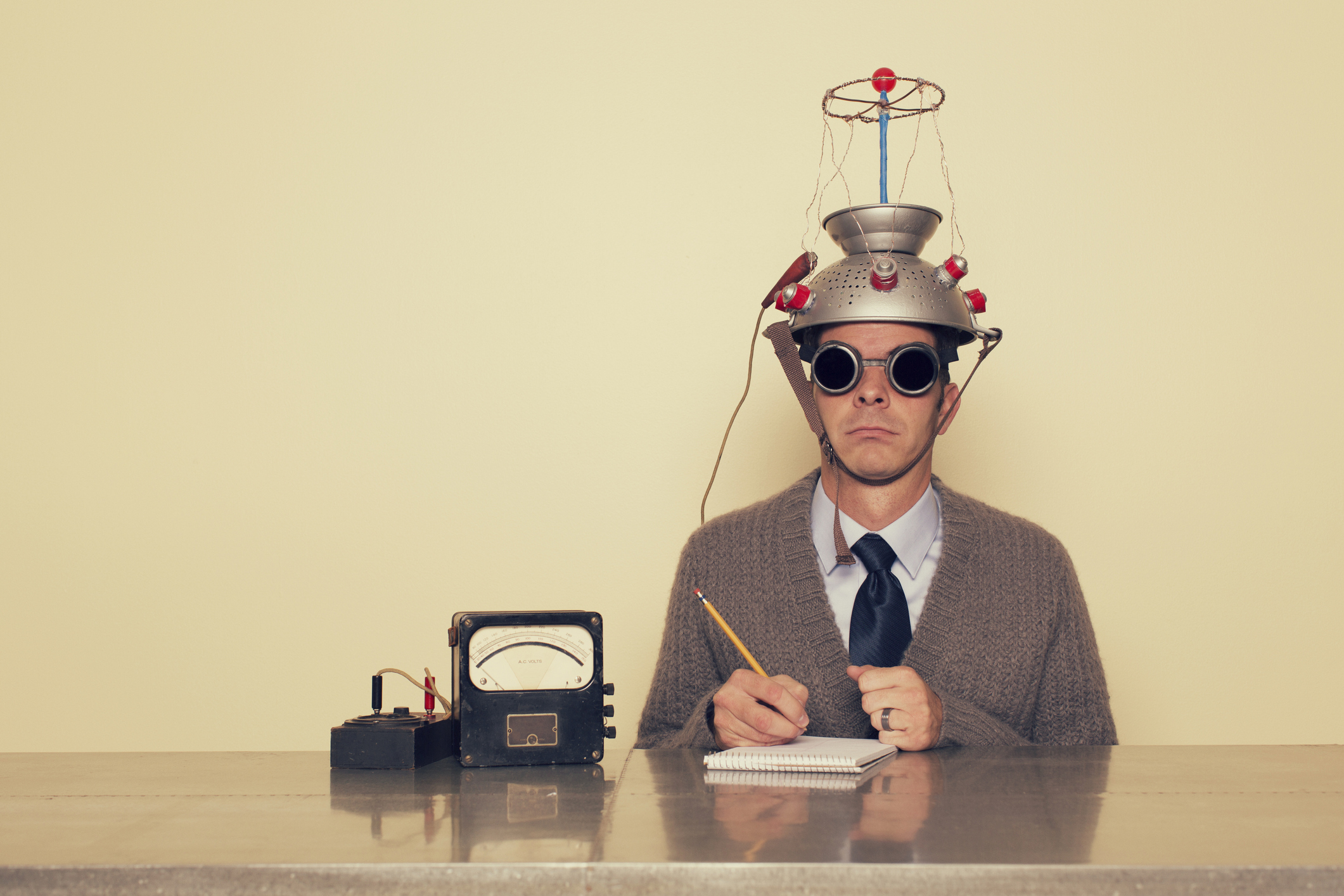 person with makeshift electrotherapy helmet