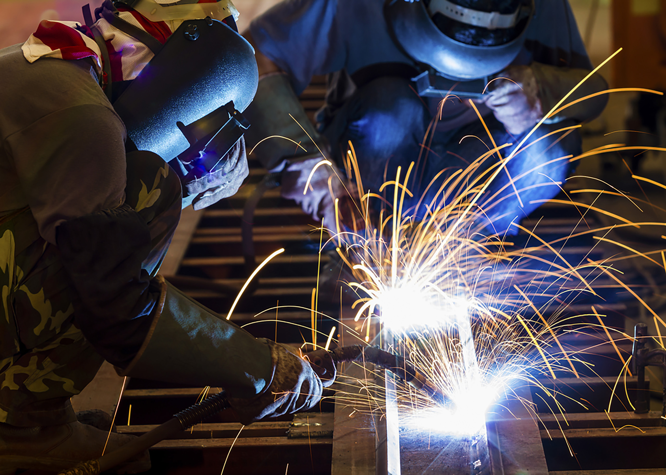 welders with sparks