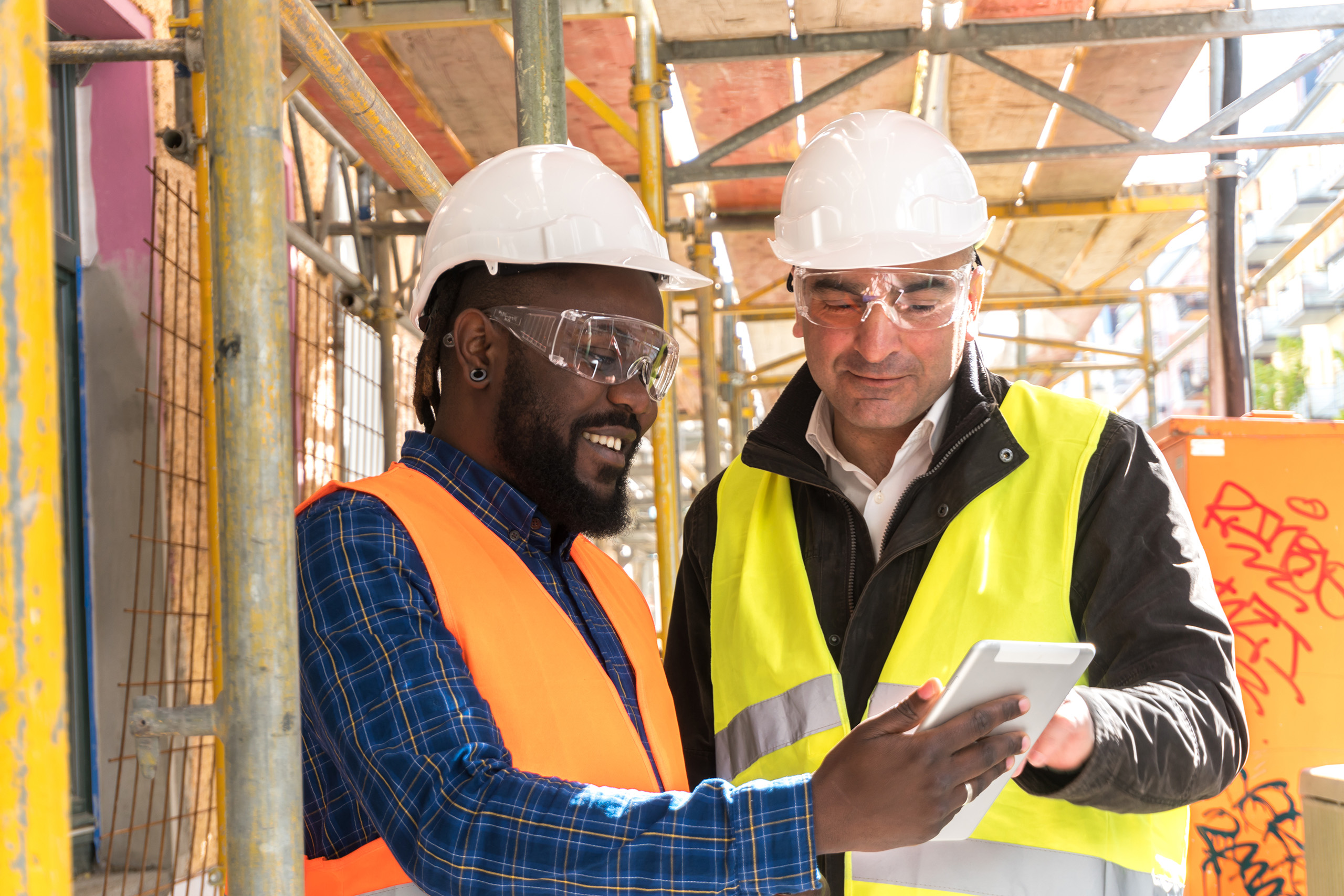 construction workers consulting tablet