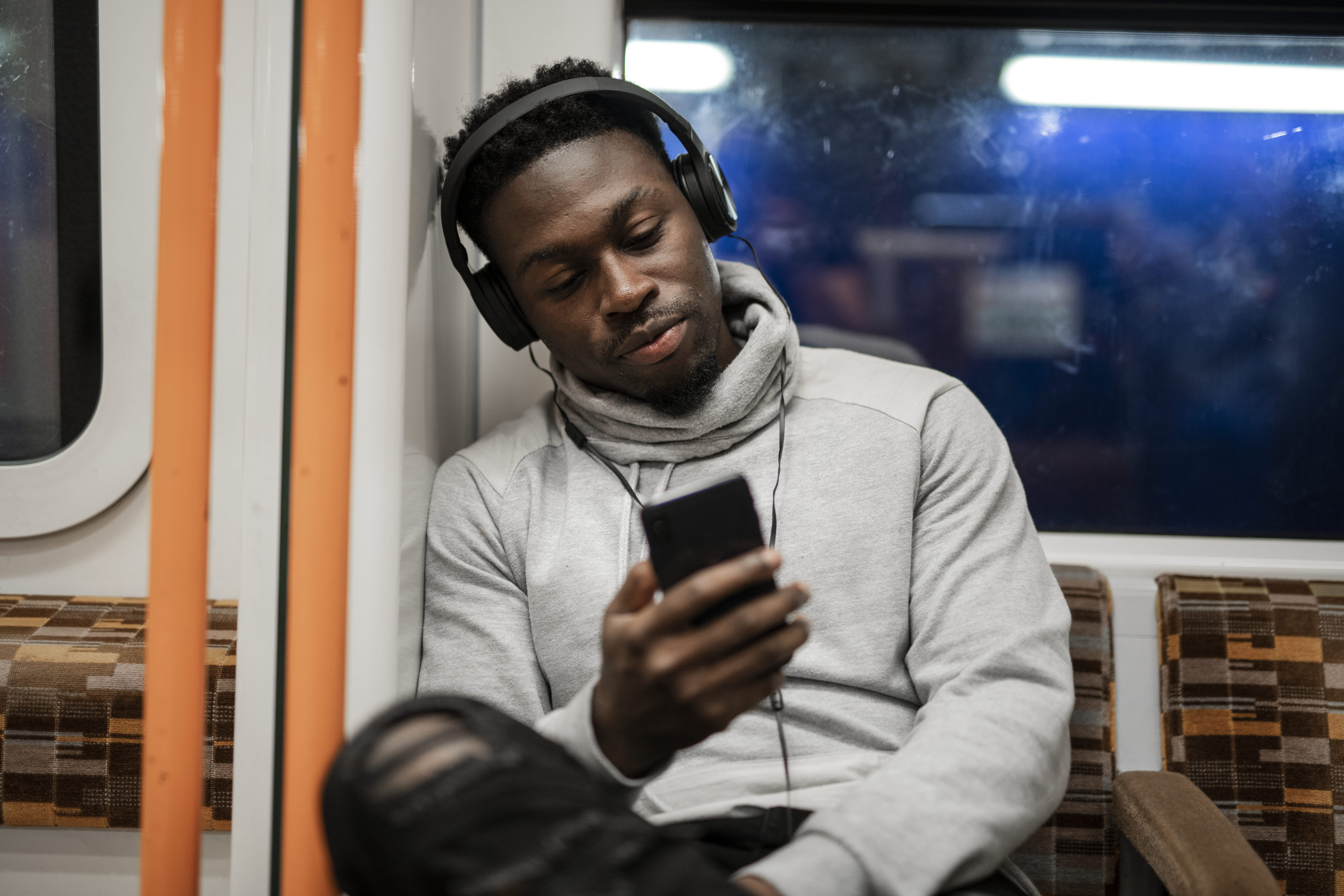 Man completing mobile safety training from his phone