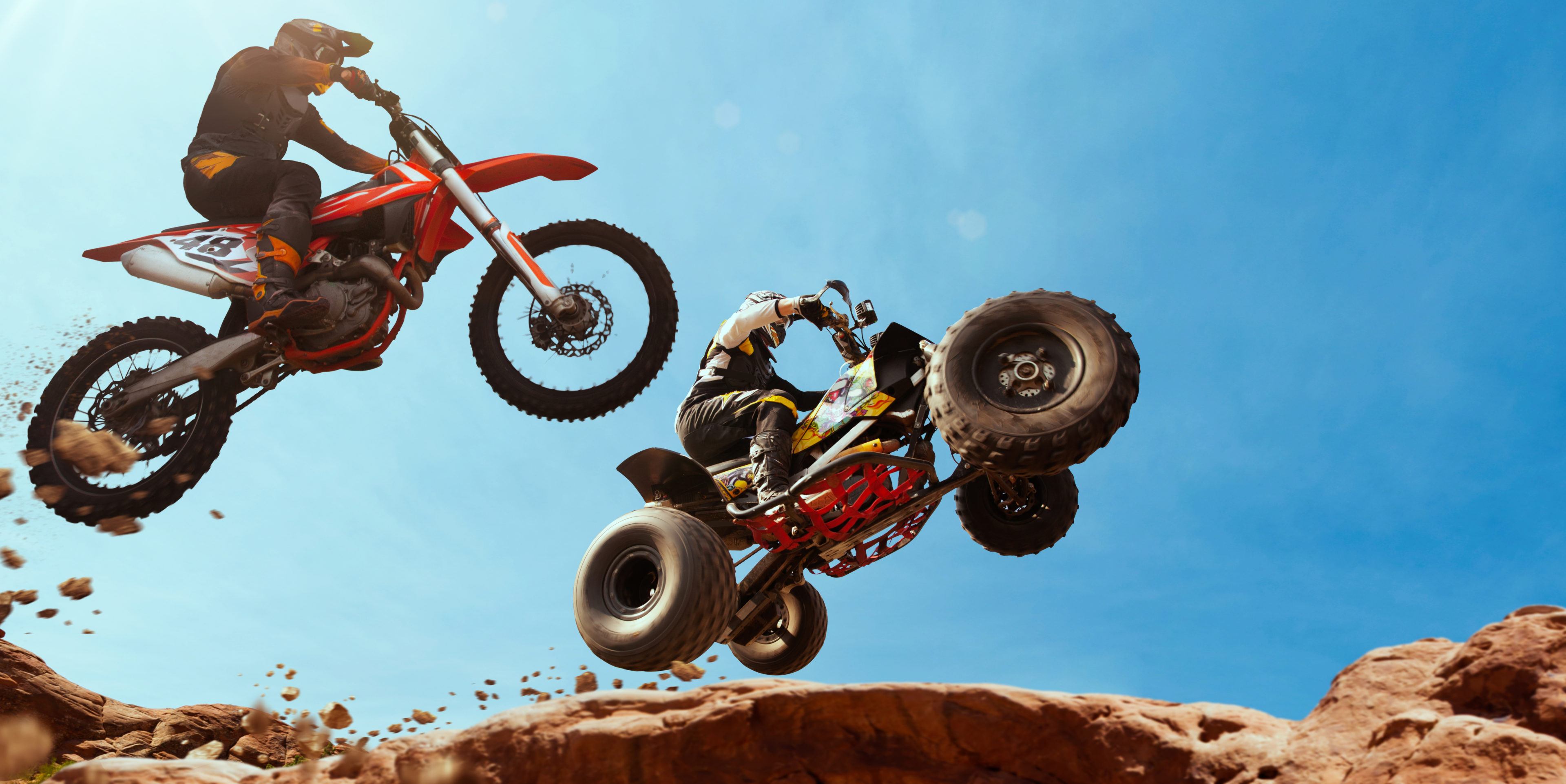 ATV Rider in the action with motocross rider.