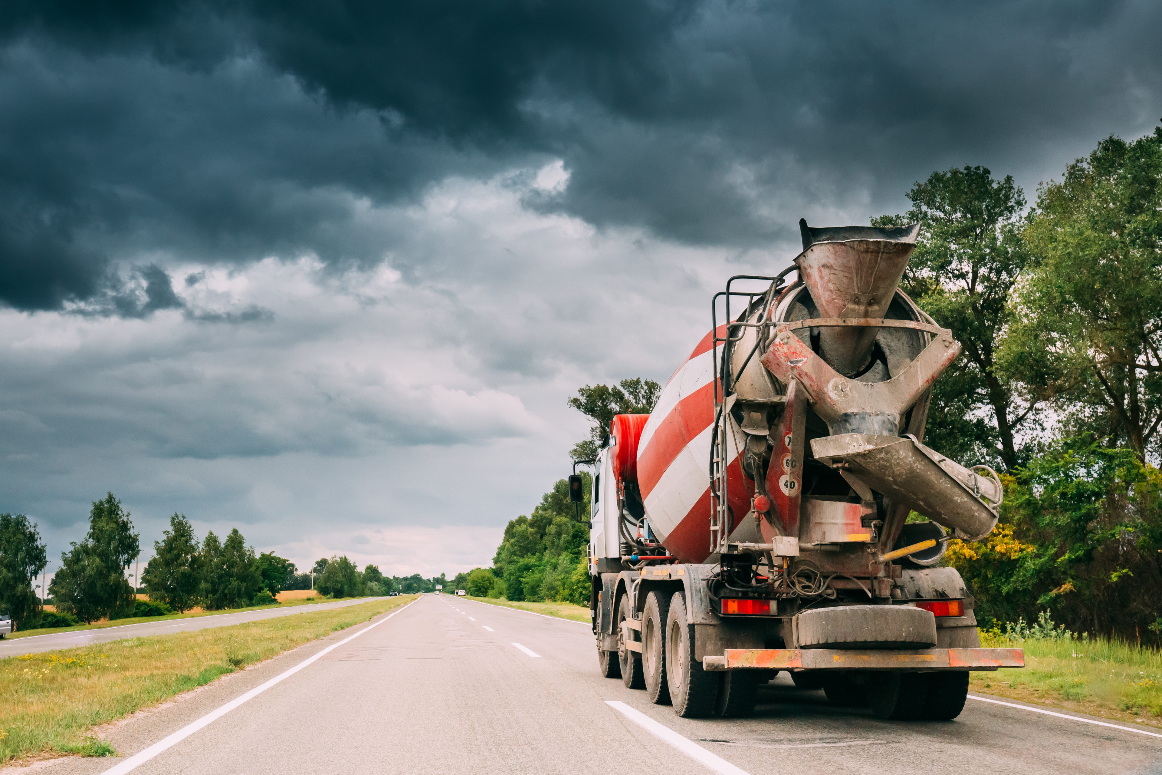 Special Concrete Transport Truck Unit In Motion On Country Road, Freeway In Europe. Asphalt Freeway, Motorway, Highway. Business Transportation And Development Concept