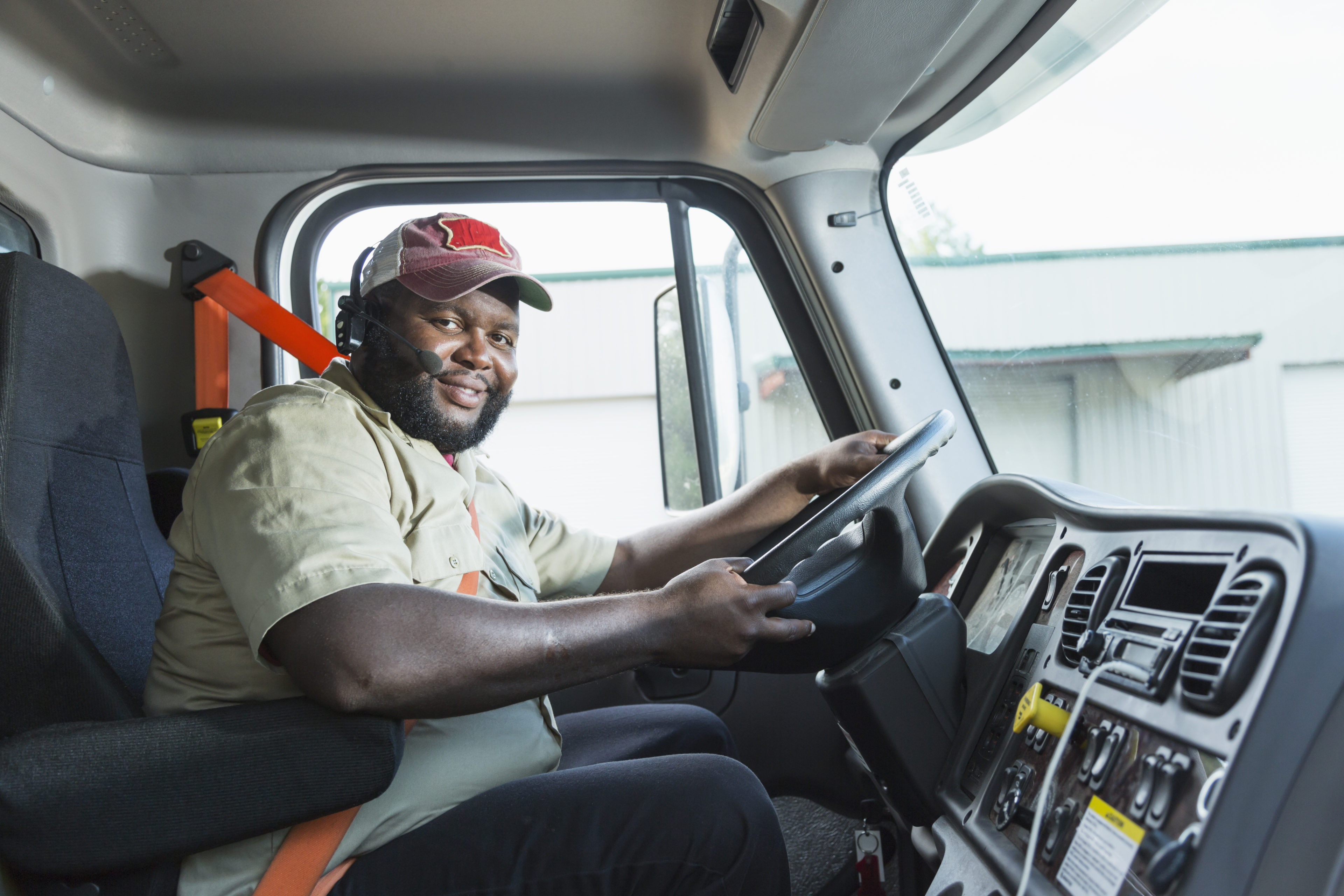 African-American truck driver in driver's seat