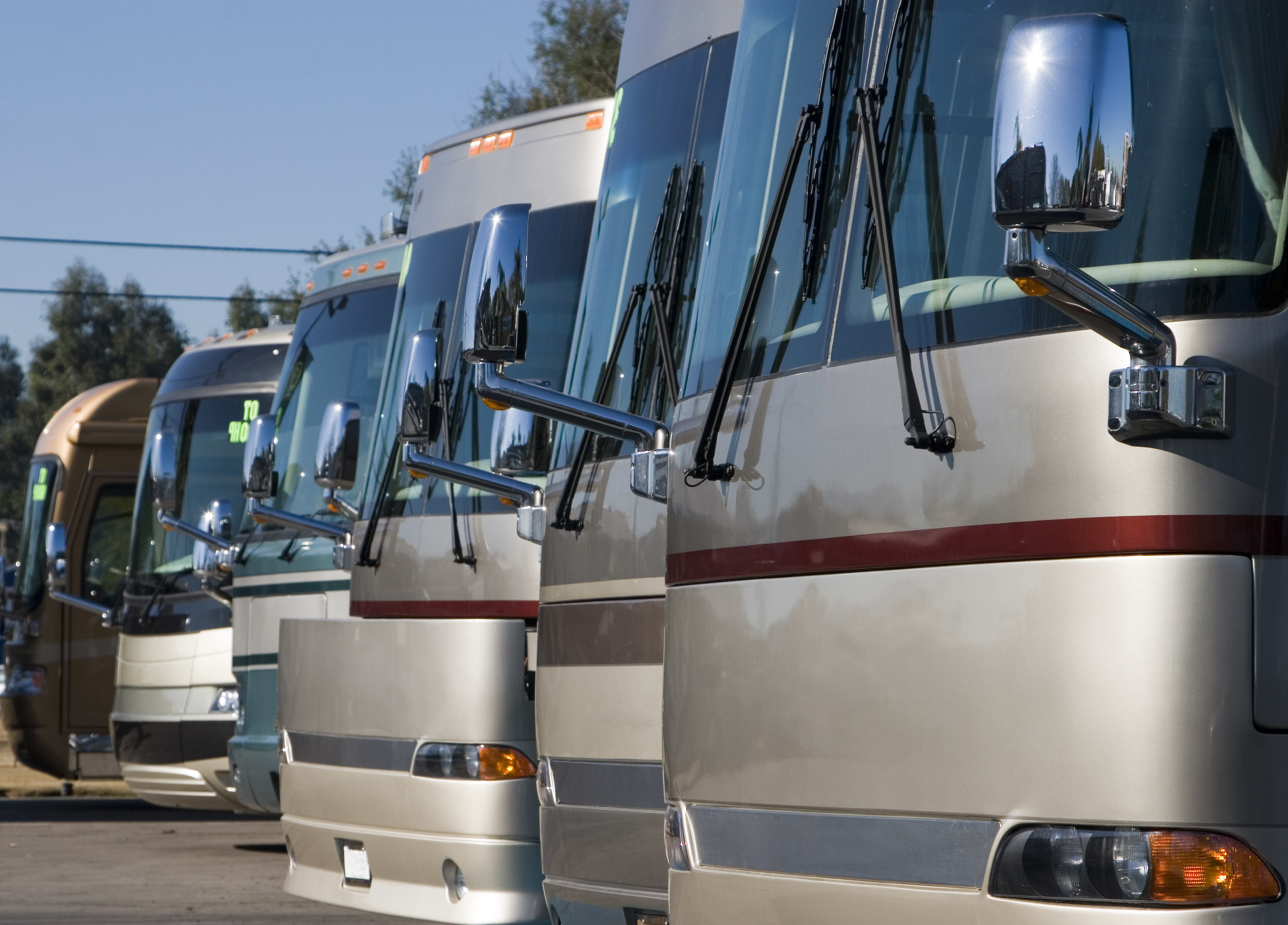 A row of RV's at a dealership.