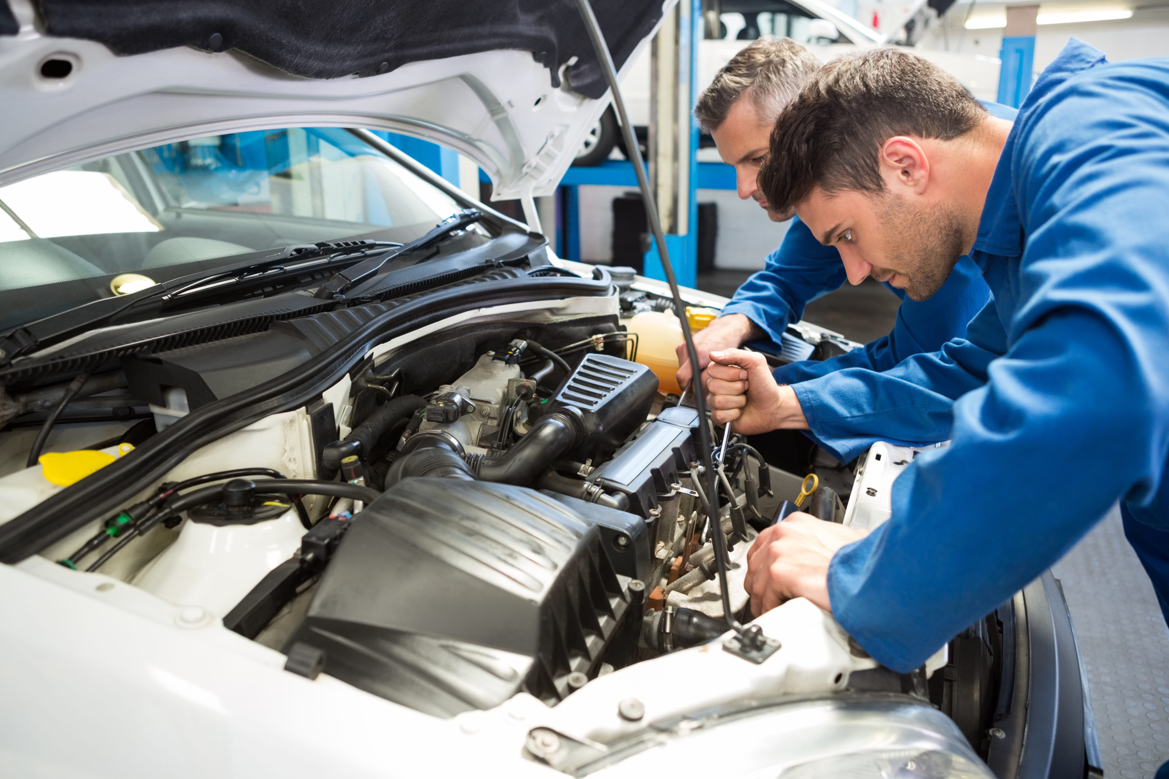 Auto mechanic's under the hood training a steps of a routine inspection