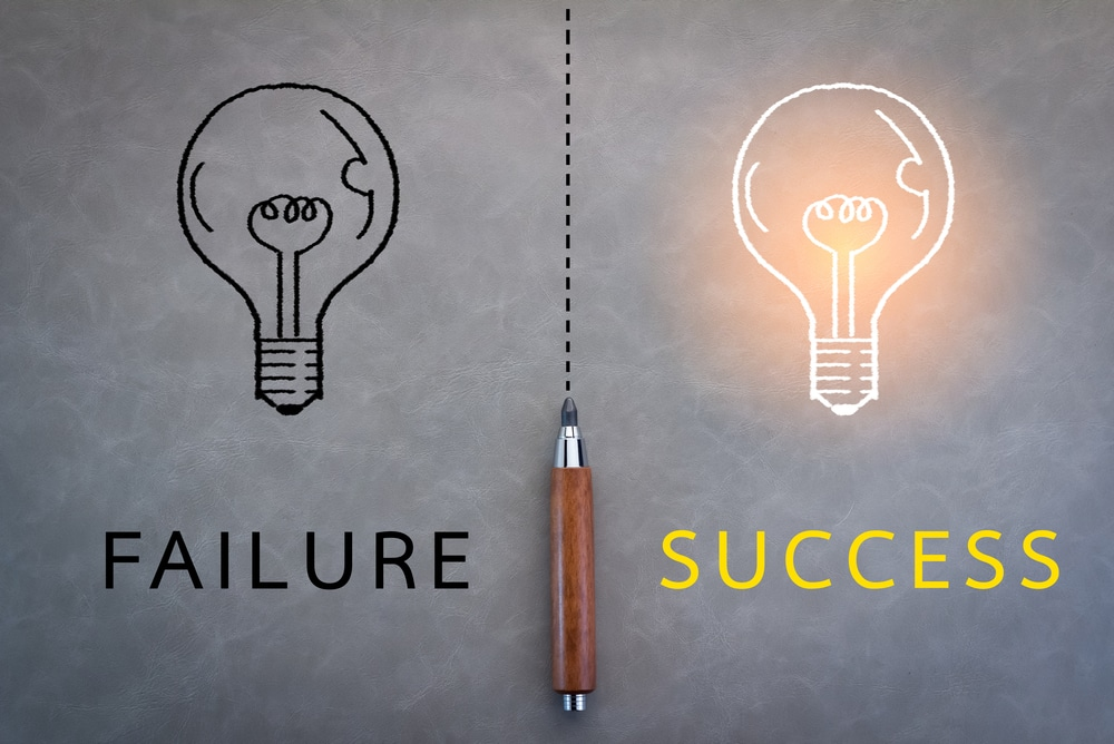 """two lightbulb graphics with text """"failure"""" and """"success"""""""