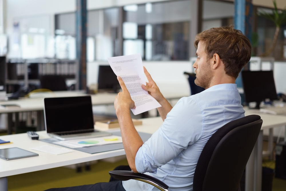 person reading office document