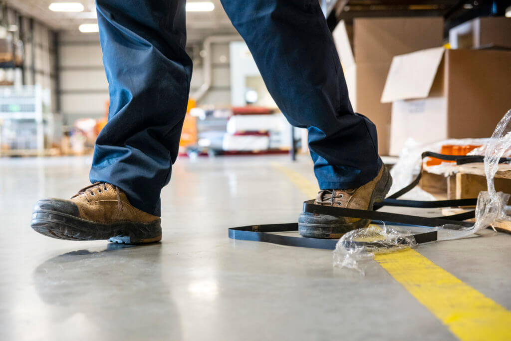 person walking in a warehouse