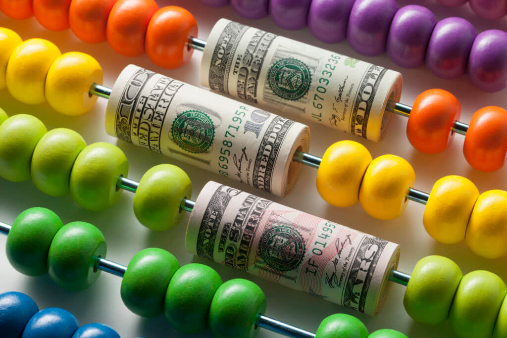 rolls of money on abacus