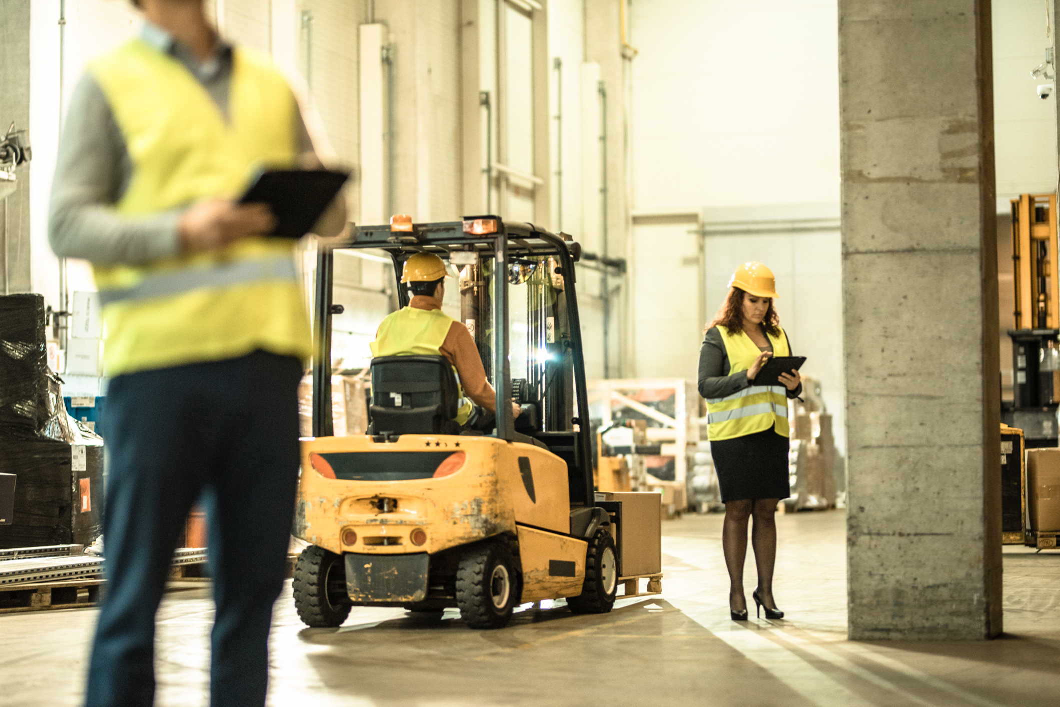 warehouse workers and forklift