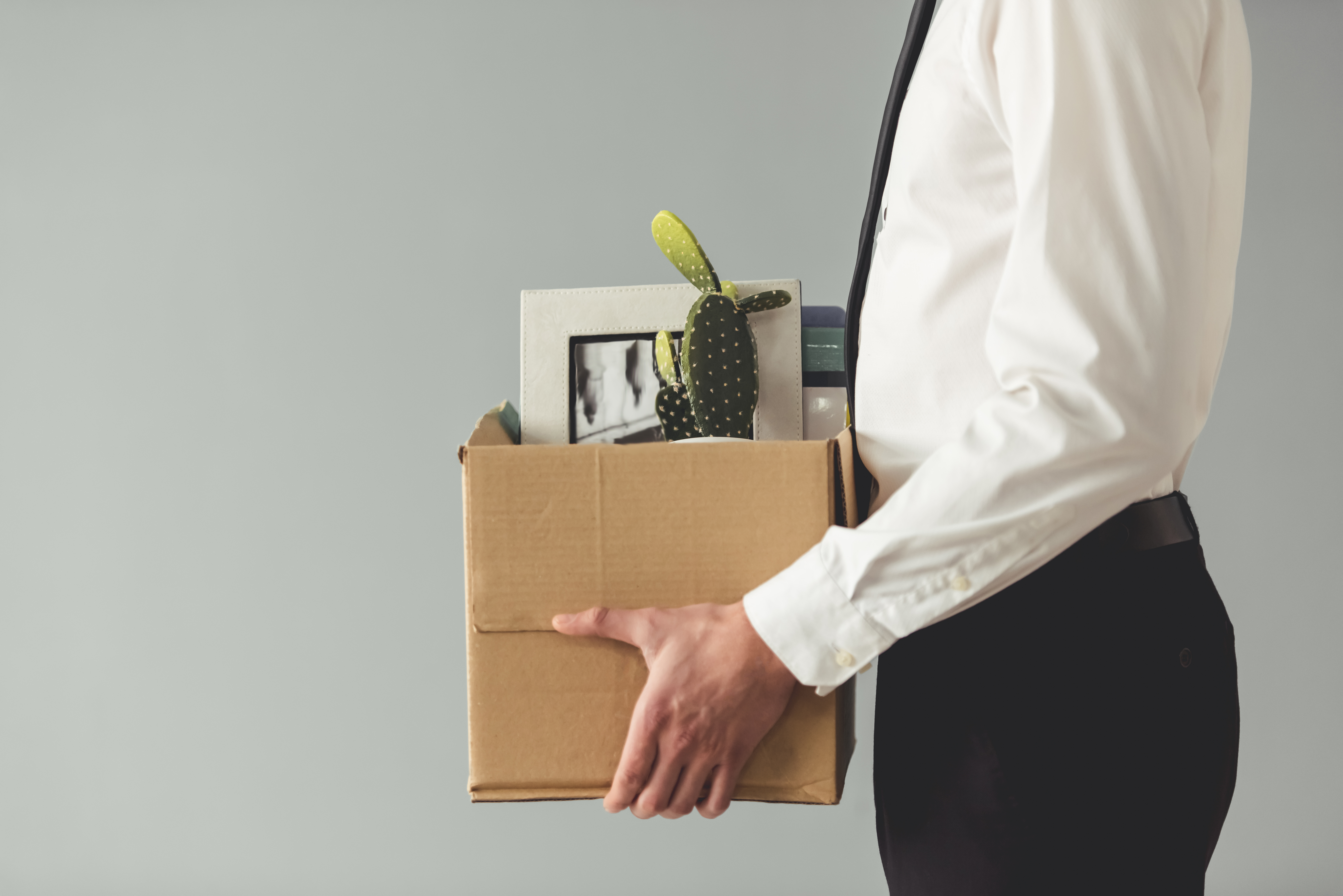 office worker carrying box of things