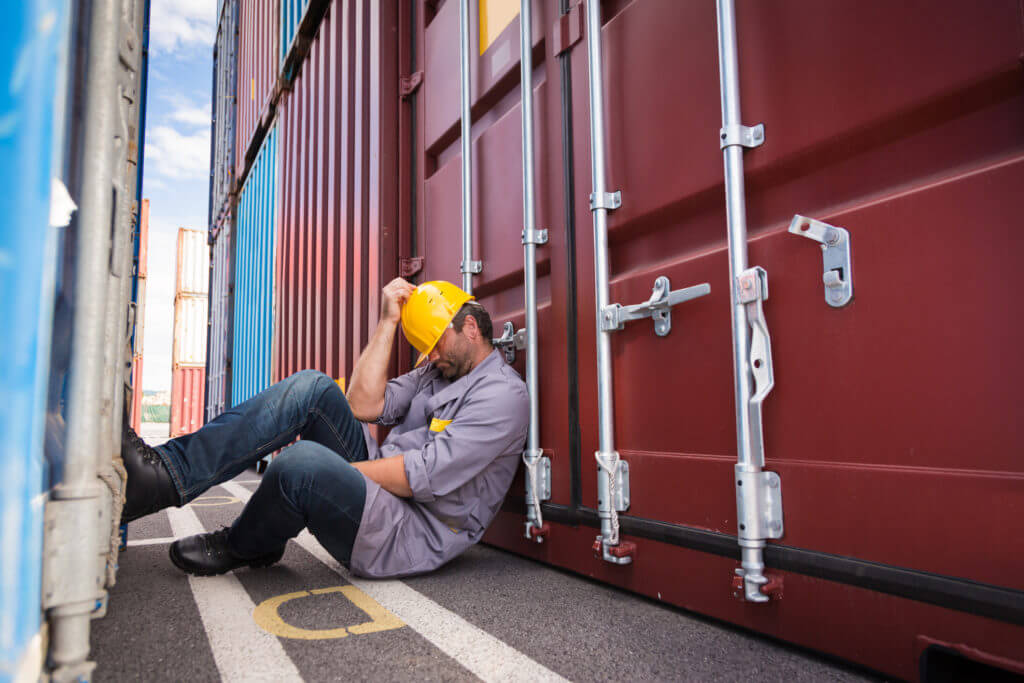 worker napping in container port