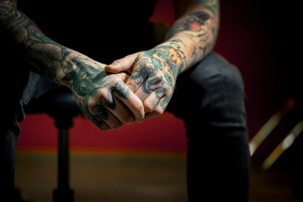 closeup of tattooed hands