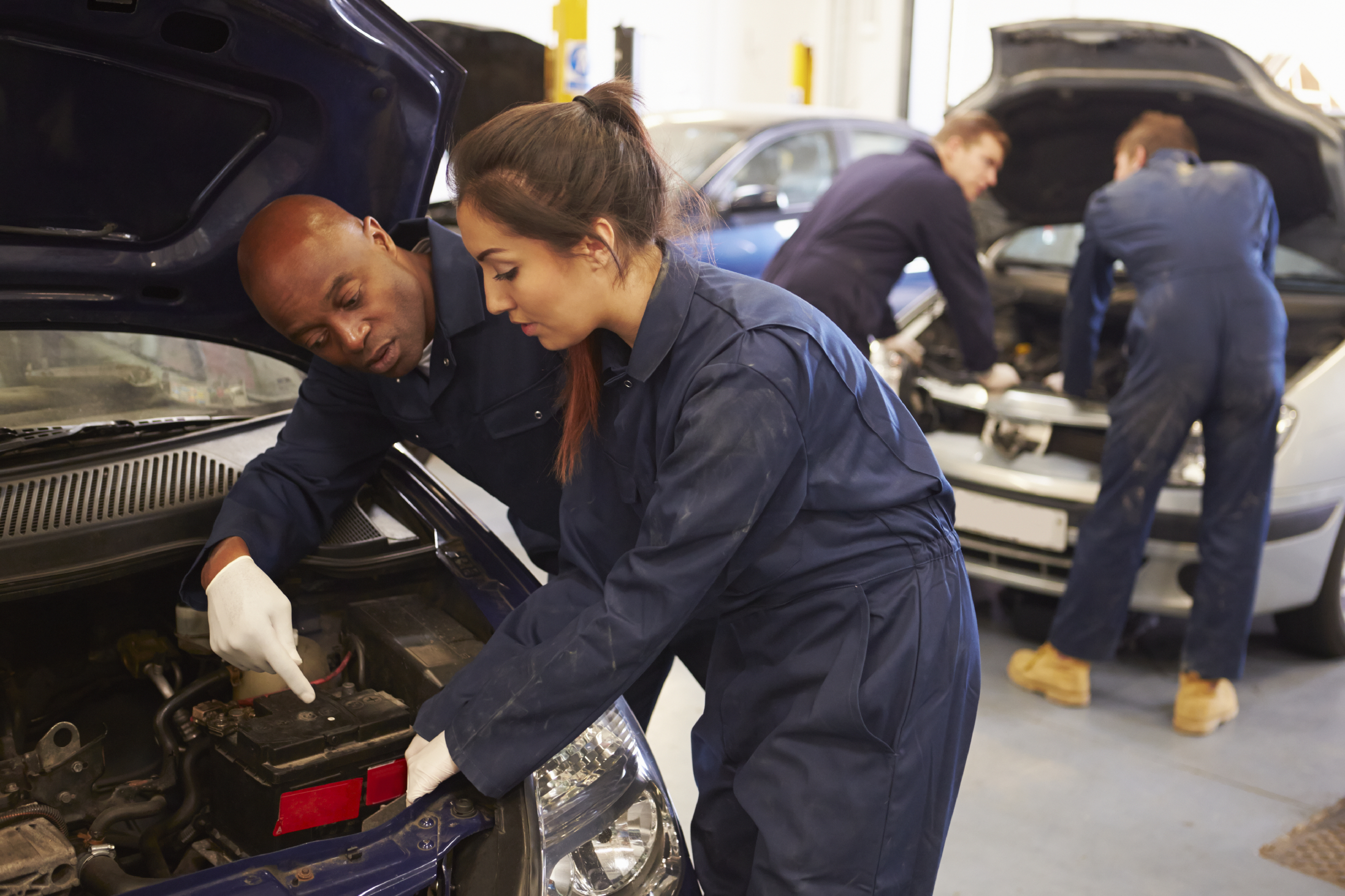 person working on car in class