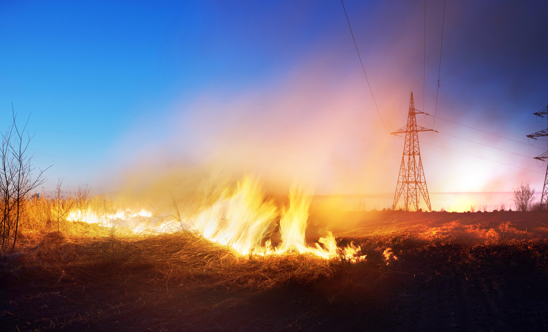 grass fire under powerlines