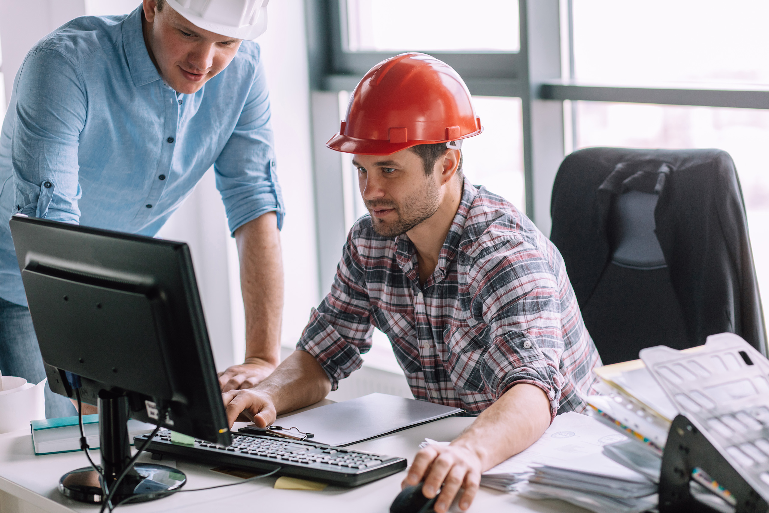 workers with construction hats and desktop