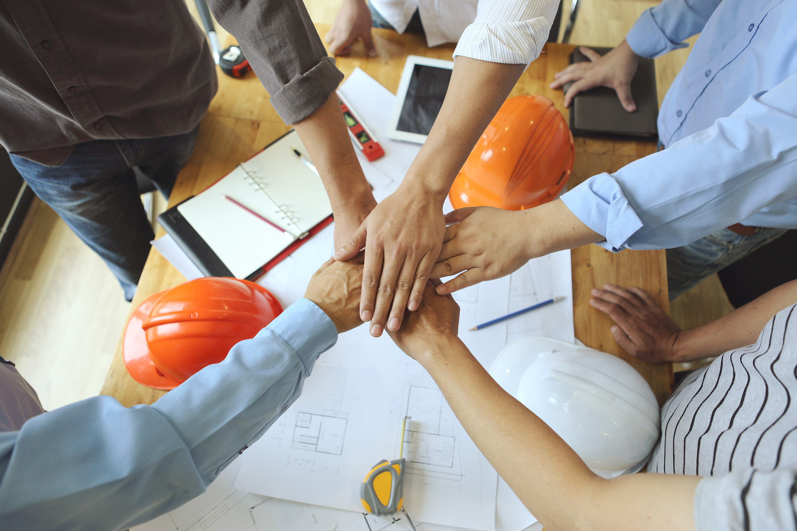 workers joining hands