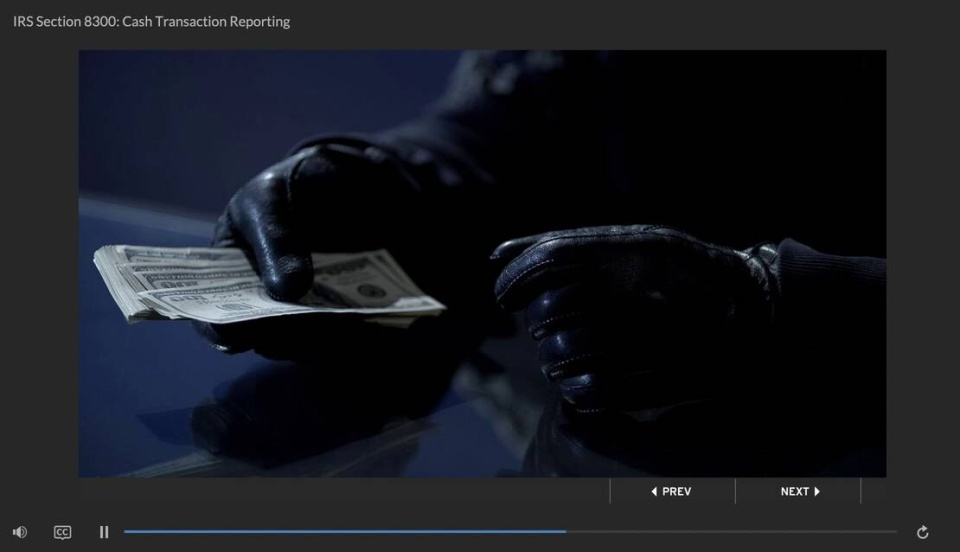 person with gloves and hundred dollar bills