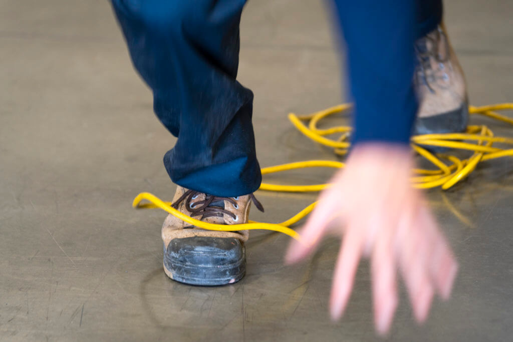 Worker trips over an electrical cord
