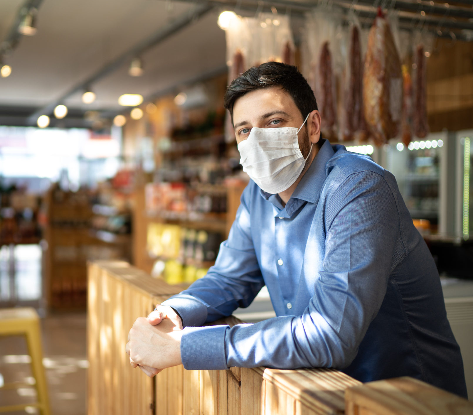 return to work at a wearhouse, wearing a facemask